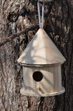 Bird House. Small,wooden bird house in a tree royalty free stock photo