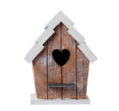 Bird House. Wooden bird house isolated on a white background royalty free stock photos