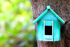 Bird house. Hanging from the tree stock photos