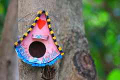 Bird house. Hanging from the tree Stock Image
