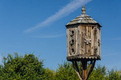 Bird house. A bird house on a background of tree tops and sky Stock Image