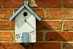 Bird house. A bird house attached to a brick wall stock images