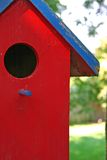 Bird house. Red bird house hanging in a tree Royalty Free Stock Photo