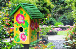 Bird House. Beautiful bird house in a lush garden royalty free stock images