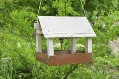 Bird house bird feeders. In the garden royalty free stock photo