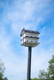 Bird house with blue sky Stock Photo