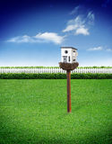 Bird house with blue sky Stock Image
