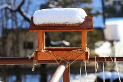 A bird house covered with snow in morning royalty free stock images