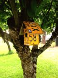 Bird house. Cute bird house made with liscence plates royalty free stock photos