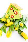 Bird house on flowers Stock Photography