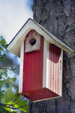 A Bird House in a forest. Photo of a red Bird House in a forest royalty free stock photo