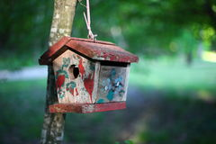 Bird house in forest. A colorful bird house with unique colors came across to me in the forest Royalty Free Stock Photos