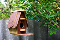 Bird house. Hanging amidst branches royalty free stock photo