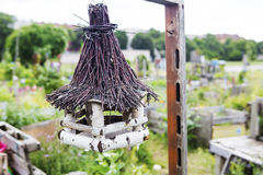Bird house hanging in a garden Royalty Free Stock Image