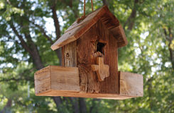 Bird house. Hanging wooden bird house with Texas shape stock photography