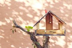 Bird house. Little wooden bird house on tree stock photos