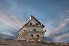 Bird House. Multi level bird house under a beautiful clouded sky Stock Photo