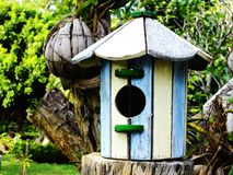 Bird house with natural green leaves background Royalty Free Stock Photo