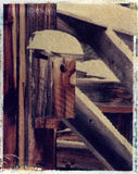 Bird house on an old barn - Polaroid image transfe Stock Photo