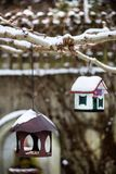 Bird house with seeds to feed birds in winter time Royalty Free Stock Images