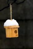 Bird house in the snow Stock Photos