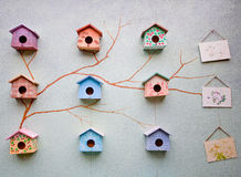 Bird house on wall royalty free stock photo
