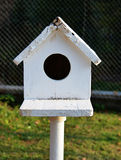 Bird house. White bird house in the garden stock images