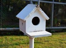 Bird house. White bird house in the garden royalty free stock photo