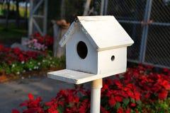 Bird house. White bird house in the garden stock photography