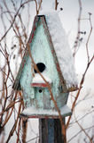 Bird House in Winter. Antique bird house on a fence photographed after a snow storm stock photos