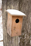 Bird house in winter Royalty Free Stock Photos