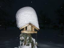 Bird house in winter. Bird house with snowdrift in dark winter night stock photos