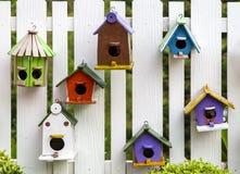 Bird house on wood fence stock image