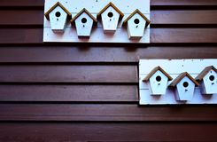 Bird house with wooden wall, background image. Bird house wooden wall background image brown plank stock photo