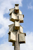 Bird houses. A birds skyscraper with a blue sky in background Royalty Free Stock Photos