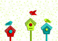 Bird houses and love birds valentines card. Valentines card with bird houses and heart leaves background Royalty Free Stock Images