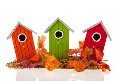 Bird houses with seed and leaves Royalty Free Stock Photography