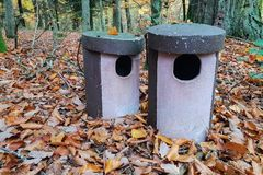 Bird houses. Bird houses stand in autumn forest.  stock photography