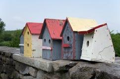 Bird Houses on Stone Wall Stock Image