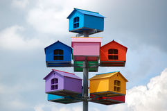 Bird houses. There are some houses for birds against the background of the sky Stock Photos