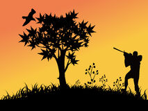 Bird hunting. Silhouettes of  a man hunting birds Royalty Free Stock Photo
