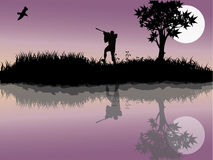 Bird hunting. Silhouettes of  a man hunting birds Stock Image