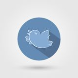 Bird icon with shadow. Elegant flying and tweeting bird icon with long shadow. Vector illustration Royalty Free Stock Photo