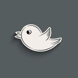 Bird icon with shadow. Elegant flying and tweeting bird icon with shadow. Vector illustration Royalty Free Stock Photos