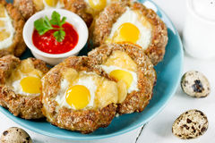 Bird nest Easter recipe - meat nests , baked minced meat cutlet. Stuffed with quail eggs and cheese stock image
