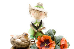 Bird nest with gardener doll Stock Photos
