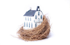 Bird nest and house(real estate economy) Royalty Free Stock Photography