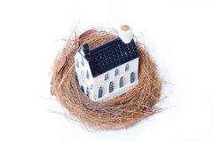 Bird nest and house,real estate economy Stock Photography