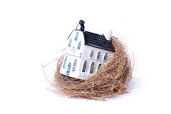 Bird nest and house,real estate economy Stock Photo