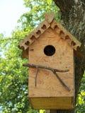 Bird nesting-box hanging in tree stock photos